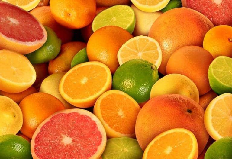 Imagem de laranjas, limões e toranja.