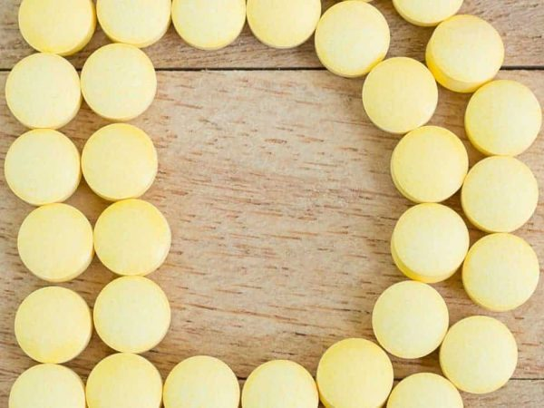 pilulas formando um D de vitamina d