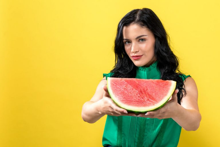 woman showing a watermelon