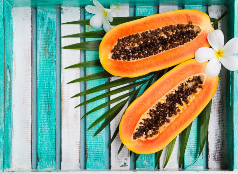 papaya on a tropical background